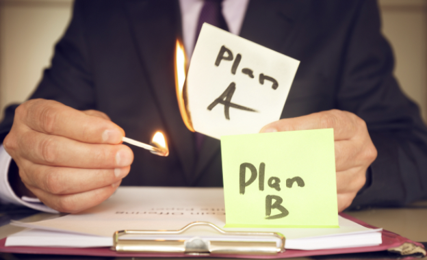 Professional lighting note with Plan A written on it on fire, with a Plan B note nearby.