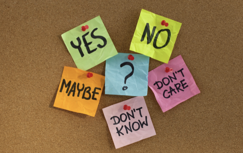 post it notes on corkboard with decision options